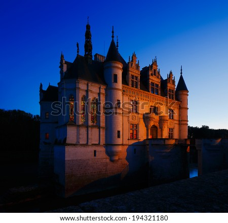 CHENONCEAUX, FRANCE - OCT 29: Castle of Chenonceau at dusk on Oct 29, 2013 in Chenonceaux, France. The castle was built on the site of an old mill on the River Cher in the 11th century