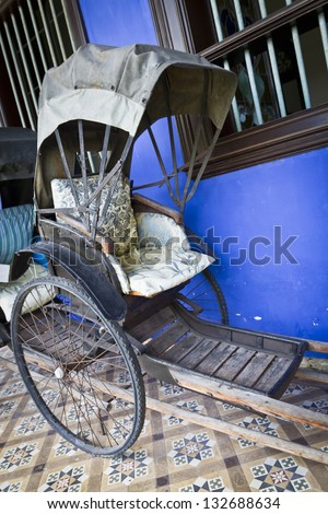 Cheong Fatt Tze's Blue Mansion in Georgetown, Penang, Malaysia. Photo of an old Tuk-Tuk. - stock photo