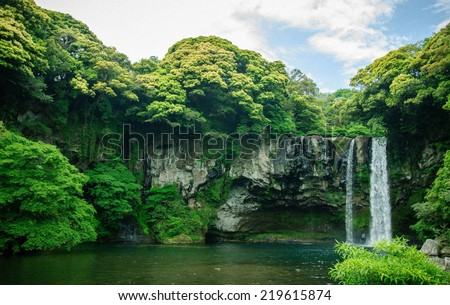 Cheonjiyeon Waterfall is a waterfall on Jeju Island, South Korea. The name Cheonjiyeon means sky. This picture could be use in promoting the place. - stock photo