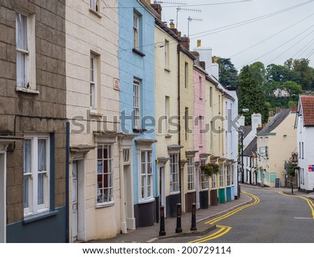 CHEPSTOW, WALES - 23 SEPTEMBER 2013: Brightly colored houses in the border town of Chepstow in Wales, UK, also known for its historic castle - stock photo