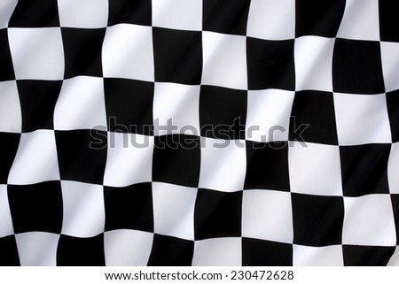 Chequered Flag - traditionally used in auto racing and similar motorsports to indicate the end of a race. The first past the chequered flag is the winner of the race.