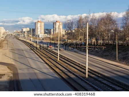 Cherepovets, Russia - April 11, 2016: Cars driving on the road, traffic in the spring morning - stock photo
