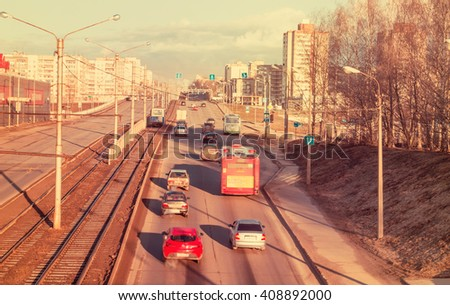 Cherepovets, Russia - April 11, 2016: Cars driving on the road, traffic in the spring morning. Image with vintage filter - stock photo