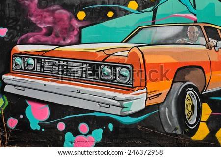 CHEREPOVETS, RUSSIA 28 APRIL 2012: Colorful graffiti urban art line with vintage car on the street walls - stock photo
