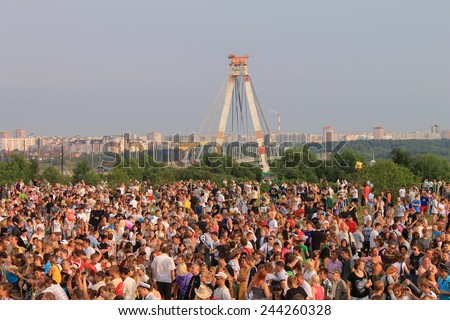 CHEREPOVETS, RUSSIA July, 15: Crowd of people celebrating feast day of the city on July 15, 2012 in Cherepovets, Russia - stock photo
