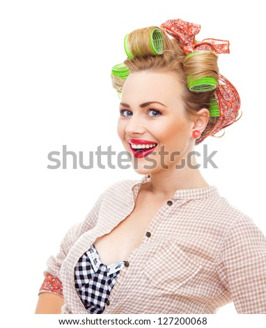 Cherfull smiling pin up retro girl with curlers. Close-up young housewife isolated on white background - stock photo