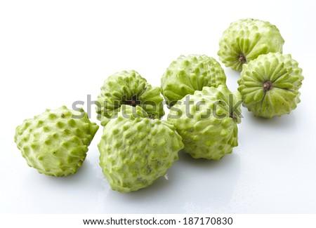 Cherimoya fruit on white - stock photo