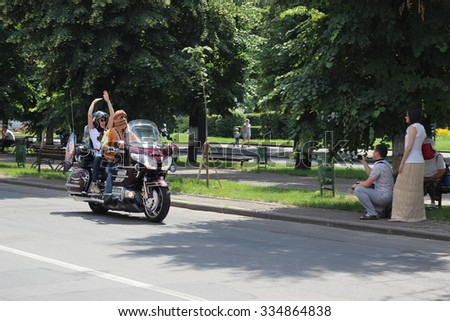 "CHERKASSY, UKRAINE - June 07, 2014: Biker show ""Tarasova Gora"". Biker on motorcycle on the street"
