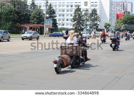 "CHERKASSY, UKRAINE - June 07, 2014: Biker show ""Tarasova Gora"". Man and woman riding a motorcycle"