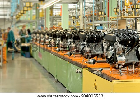 Cherkasy, Ukraine - May 29, 2012:Car engines on factory assembly line.