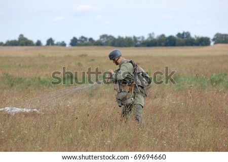 CHERNIGOW, UKRAINE - AUG 29: Member of Red Star military history club wears historical German paratrooper uniform during historical reenactment of WWII, August 29, 2010 in Chernigow, Ukraine
