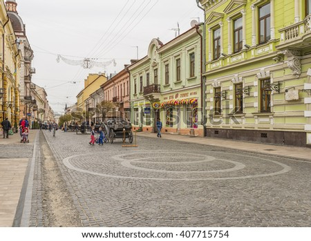 CHERNIVTSI, UKRAINE - APR 07, 2016: Architecture in the old town Chernivtsi. Tourists walk through the old town near the registry office. Day off in the city center. Western Ukraine.