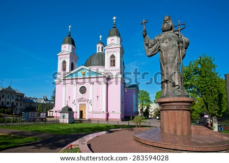 CHERNIVTSI, UKRAINE - APR 24, 2015: Pink color cathedral and monument to Metropolit of Bukovina and Dalmatia on April 29 2015. Chernivtsi situated on Ukrainian part of the Bukovina with popul. 240,600 - stock photo