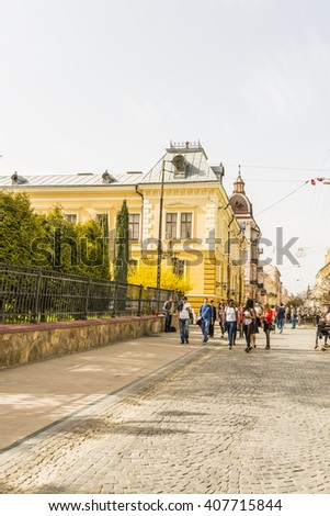 CHERNIVTSI, UKRAINE - APR 07, 2016: Students walk near the historical museum. Architecture in the old town Chernivtsi. Day off in the city center. Western Ukraine.