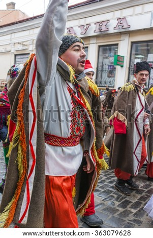CHERNIVTSI, UKRAINE - JAN 15, 2015:  Malanka Festival in Chernivtsi. Folk festivities on the streets dressed people in historical costumes. Malanka in historical costumes war the Russian army. - stock photo
