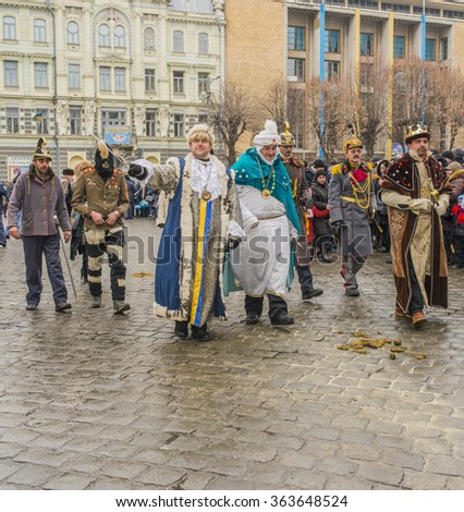 CHERNIVTSI, UKRAINE - JAN 15, 2015: Malanka Festival in Chernivtsi. Folk festivities on the streets dressed people in historical costumes.  Malankain the costumes of the king and court soldier. - stock photo