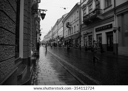 CHERNIVTSI, UKRAINE - NOVEMBER 14, 2013: Architecture and streets of the old town. The historic architecture of Chernivtsi, Ukraine. Old city after the rain.