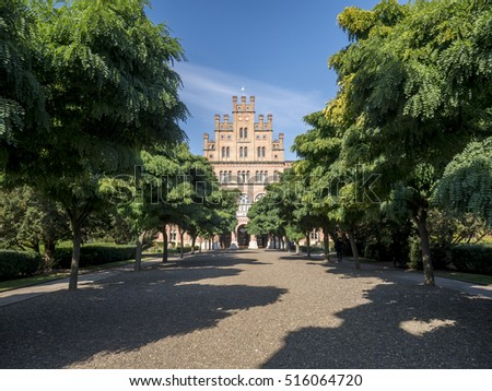 CHERNIVTSI/UKRAINE 07TH OCTOBER 2016: Front view of Chernivtsi National University through an avenue of autumnal trees