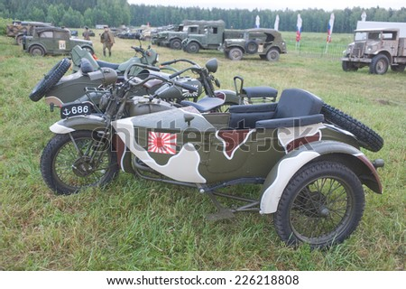 "CHERNOGOLOVKA, MOSCOW REGION, RUSSIA -JUNE 21, 2013:  Japanese old military Rikuo motorcycle Type 97 (a copy of the Harley-Davidson) at the 3rd international meeting of ""Motors of war"" , side view"