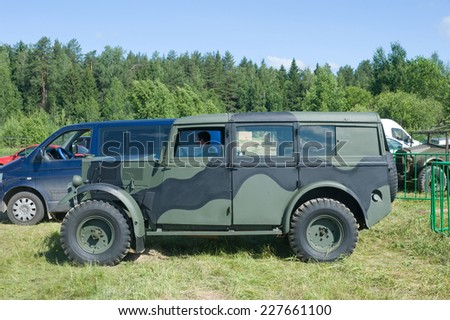"CHERNOGOLOVKA, MOSCOW REGION, RUSSIA - JUNE 21, 2013: The British commander's car ""Humber""  FWD at the 3rd international meeting of ""Motors of war"" near the town of Chernogolovka, side view"