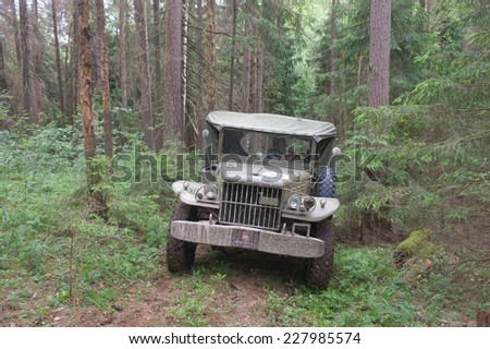 "CHERNOGOLOVKA, MOSCOW REGION, RUSSIA-JUNE 21, 2013: U.S. army Dodge WC-51 in the woods on a heavy road, 3rd international meeting ""Motors of war"" near the city Chernogolovka"