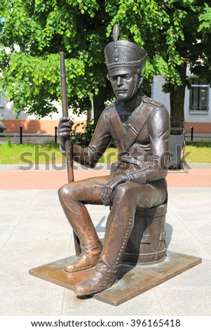 CHERNYAKHOVSK, RUSSIA - JUNE 04, 2015: Bronze figure of the Russian soldier sitting on a drum in the sunny summer day in the city of Chernyakhovsk