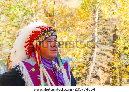 Cherokee, NC - November 4: Native American in ceremonial costume on November 4, 2008. Cherokee is the home of the Eastern Band of the Cherokee Indians and a major history, cultural and crafts center. - stock photo