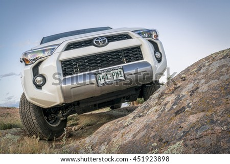 CHEROKEE PARK, CO, USA - JUNE 12, 2016: Toyota 4Runner SUV (2016 Trail edition) on a rocky  trail in Colorado's Rocky Mountains