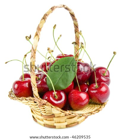 Cherries in a basket isolated on white background. - stock photo