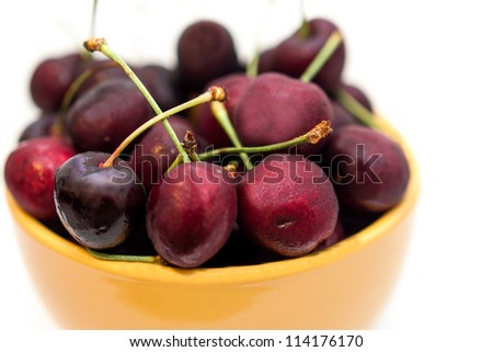 Cherries in a yellow bowl - stock photo