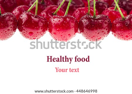 Cherry background. Bunches of ripe juicy rich shiny cherries on a white background. Isolated. Decorative fruit frame. Fresh ripe cherries with water drops. Fruit background. Copy space. - stock photo