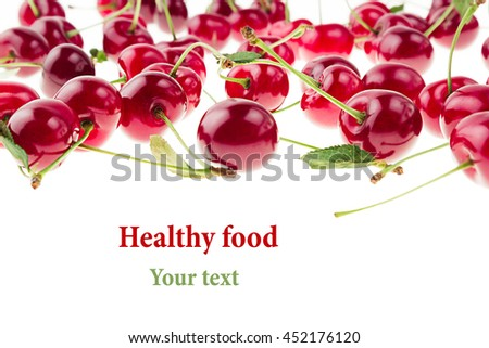 Cherry background. Bunches of ripe juicy rich shiny cherries on a white background. Isolated. Decorative fruit frame. Fresh ripe cherries with tails and leaves. Fruit background. Copy space. - stock photo