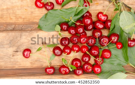 cherry background. Fresh juicy cherries on the white wooden background, top view - stock photo