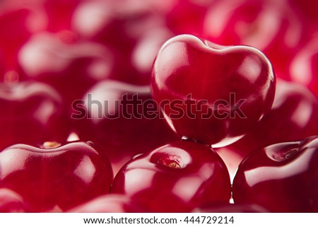 Cherry background with cherry in form of heart. Ripe fresh rich cherries. Macro. Texture.   Fruit background. Valentine's Day. - stock photo