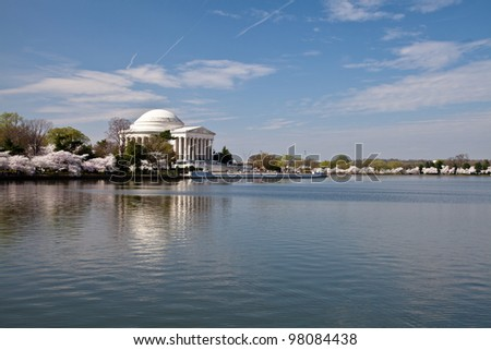 Cherry blossoms around the Tidal Basin in Washington DC with Jefferson Memorial - stock photo