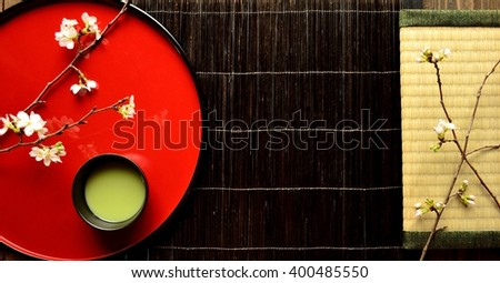 Cherry blossoms,green tea and tatami mat.Image of Japanese style interior and tea time on spring