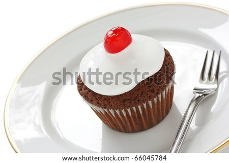cherry chocolate cupcake on the dish - stock photo
