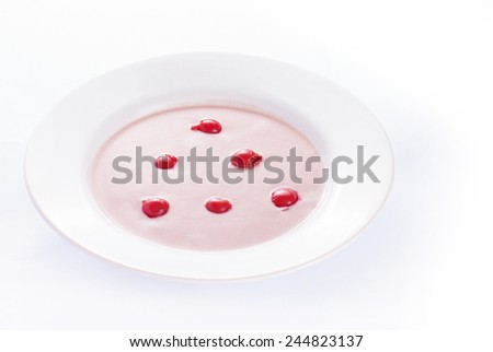 Cherry cream soup on white background