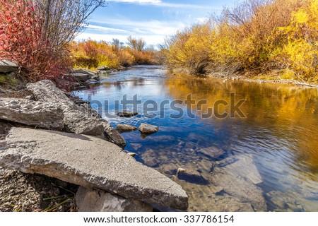 Cherry Creek running through the beautiful autumn landscape of Cherry Creek Nature Preserve on the outskirts of Bozeman, Montana - stock photo