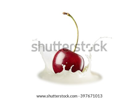 cherry falling into the milk isolated on white background.with clipping path