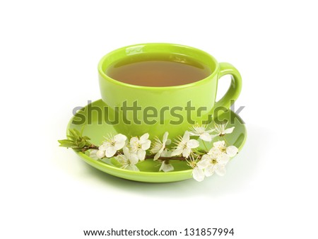 Cherry green tea in a mug on a white background isolated - stock photo