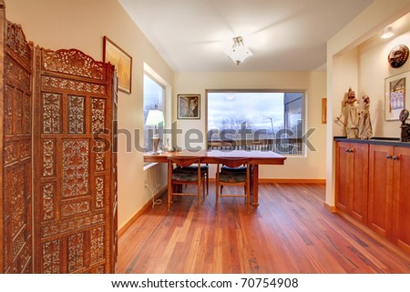 Cherry hardwood and large dining table - stock photo