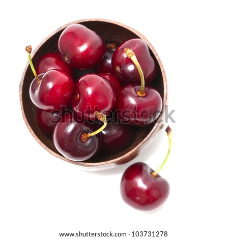 cherry in a bowl isolated on white, top view - stock photo