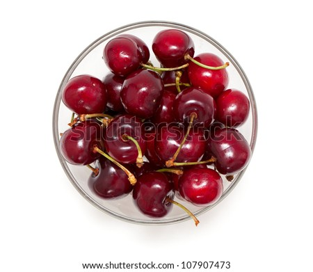 cherry in a bowl isolated on white, top view