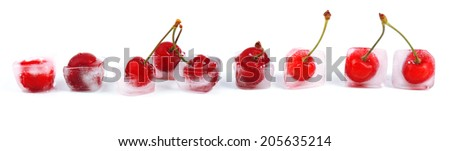 Cherry in ice cube isolated on white - stock photo