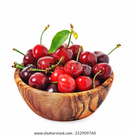 Cherry in wooden bowl, on white background - stock photo