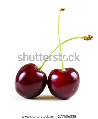 Cherry isolated on white background - vertical image