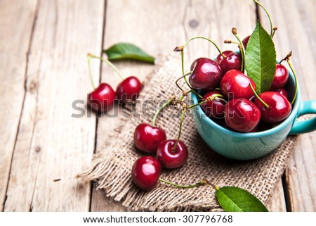 Cherry isolated on wooden background, fruits, berries - stock photo