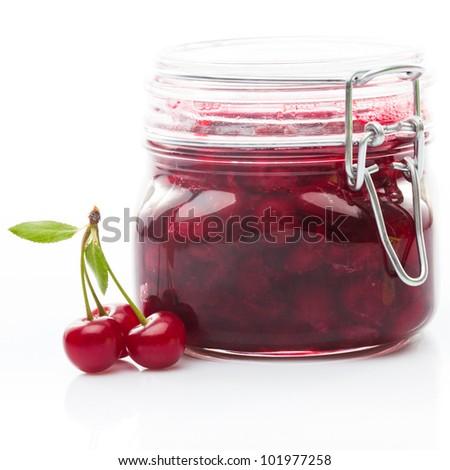 Cherry jam with fresh fruits isolated on white - stock photo