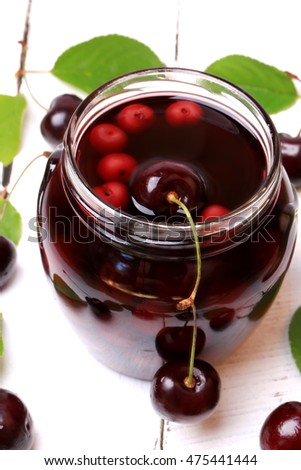 cherry juice wooden background view from above a flat kind of summer